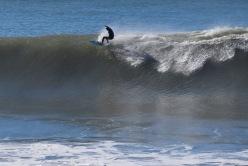 Surfer rides wave