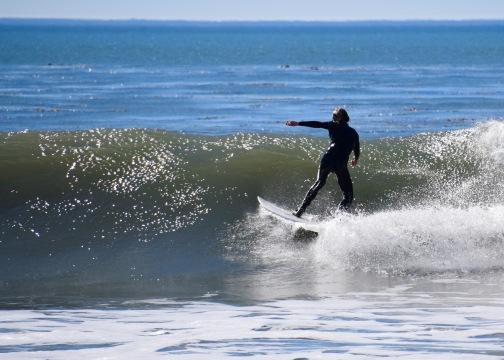 Adrian surfing